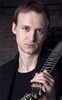 Репетитор по музыке Иван Васильевич